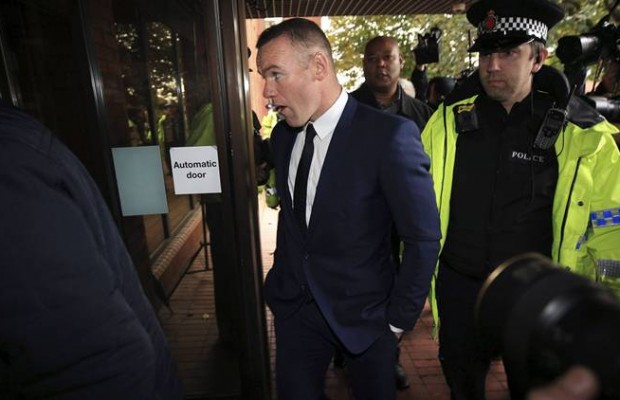 British soccer player Wayne Rooney, centre, arrives at Stockport Magistrates Court in Stockport, England, Monday, Sept. 18, 2017. The 31-year-old Everton striker is appearing in court on alleged drink driving charges.  (Peter Byrne/PA via AP)