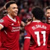 Liverpool's Roberto Firmino (right) celebrates scoring his side's fourth goal of the game with Mohamed Salah and Trent Alexander-Arnold (left)