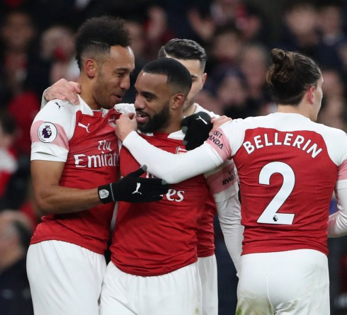 """Soccer Football - Premier League - Arsenal v Chelsea - Emirates Stadium, London, Britain - January 19, 2019  Arsenal's Alexandre Lacazette celebrates scoring their first goal with Pierre-Emerick Aubameyang and team mates  REUTERS/Hannah Mckay  EDITORIAL USE ONLY. No use with unauthorized audio, video, data, fixture lists, club/league logos or """"live"""" services. Online in-match use limited to 75 images, no video emulation. No use in betting, games or single club/league/player publications.  Please contact your account representative for further details."""