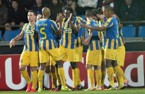 APOEL Nicosia of Cyprus' players celebrates a goal by Franco Vinicius during their Champions League play-off match against Aab Aalborg of Denmark at the Nordjyske Arena in Aalborg August 20, 2014. REUTERS/Henning Bagger/Scanpix Denmark (DENMARK - Tags: SPORT SOCCER) ATTENTION EDITORS - THIS PICTURE WAS PROVIDED BY A THIRD PARTY. FOR EDITORIAL USE ONLY. NOT FOR SALE FOR MARKETING OR ADVERTISING CAMPAIGNS. THIS PICTURE IS DISTRIBUTED EXACTLY AS RECEIVED BY REUTERS, AS A SERVICE TO CLIENTS. DENMARK OUT. NO COMMERCIAL OR EDITORIAL SALES IN DENMARK. NO COMMERCIAL SALES