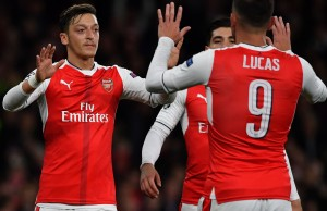 Arsenal's German midfielder Mesut Ozil (L) celebrates scoring his team's fifth goal with Arsenal's Spanish defender Hector Bellerin (C) and Arsenal's Spanish striker Lucas Perez during the UEFA Champions League Group A football match between Arsenal and Ludogorets Razgrad at The Emirates Stadium in London on October 19, 2016. / AFP / BEN STANSALL        (Photo credit should read BEN STANSALL/AFP/Getty Images)