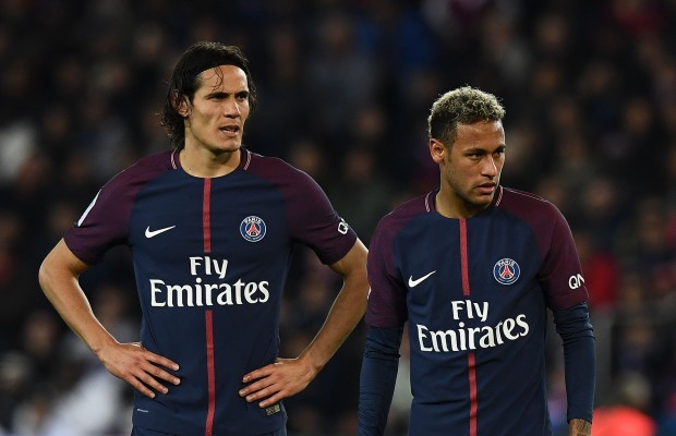 (FILES) This file photo taken on September 18, 2017 shows Paris Saint-Germain's Uruguayan forward Edinson Cavani (L) and Paris Saint-Germain's Brazilian forward Neymar reacting during the French Ligue 1 football match between Paris Saint-Germain (PSG) and Lyon (OL) at the Parc des Princes stadium in Paris.  Paris Saint-Germain kept their perfect start to the season going, but the 2-0 win over Lyon also laid bare certain tensions in their all-star front line. / AFP PHOTO / FRANCK FIFE
