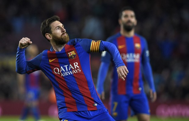 Barcelona's Argentinian forward Lionel Messi celebrates after scoring a goal during the Spanish league football match FC Barcelona vs CA Osasuna at the Camp Nou stadium in Barcelona on April 26, 2017. / AFP PHOTO / LLUIS GENE