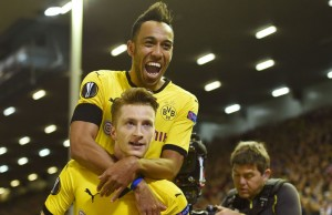 LIVERPOOL, ENGLAND - APRIL 14:  Marco Reus of Borussia Dortmund celebrates scoring his team's third goal with Pierre-Emerick Aubameyang during the UEFA Europa League quarter final, second leg match between Liverpool and Borussia Dortmund at Anfield on April 14, 2016 in Liverpool, United Kingdom.  (Photo by Shaun Botterill/Getty Images)