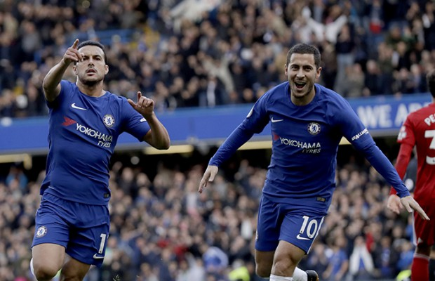 Chelsea's Pedro celebrates scoring his side's first goal next to Eden Hazard, right, during the English Premier League soccer match between Chelsea and Watford at Stamford Bridge stadium in London, Saturday, Oct. 21, 2017. (AP Photo/Matt Dunham)
