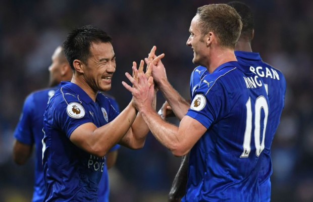Leicester City's Japanese striker Shinji Okazaki (L) celebrates with Leicester City's Welsh midfielder Andy King after scoring his and Leicester's second goal during the English League Cup third round football match between Leicester City and Chelsea at King Power Stadium in Leicester, central England on September 20, 2016. / AFP / Anthony DEVLIN / RESTRICTED TO EDITORIAL USE. No use with unauthorized audio, video, data, fixture lists, club/league logos or 'live' services. Online in-match use limited to 75 images, no video emulation. No use in betting, games or single club/league/player publications.  /         (Photo credit should read ANTHONY DEVLIN/AFP/Getty Images)